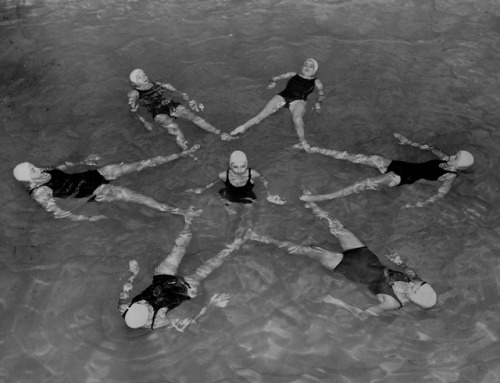 """Synchronized swimming: rehearsal for ""Snowball Bounce,"" the pool, Barnard Hall, December 1951."" (Barnard College Archives)"