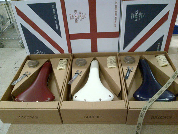 All things British   Union Jack Brooks Swallow Saddles Brooks has proudly manufactured leather goods in the West Midlands of England for nearly 150 consecutive years. During that time Brooks have seen the no less that three Olympiads take place in London. To mark the special occasion, Brooks have created the Union Jack Swallows Limited Edition saddle range. The saddles are a tricolour issue of the legendary B15, the original precursor to the modern racing saddle, which Brooks first patented in 1937. Just 500 saddles will be made by Brooks at their factory in Smethwick, England. The Red and Blue models will feature a unique Union Jack box, while the White saddle have St. George's flag packaging.