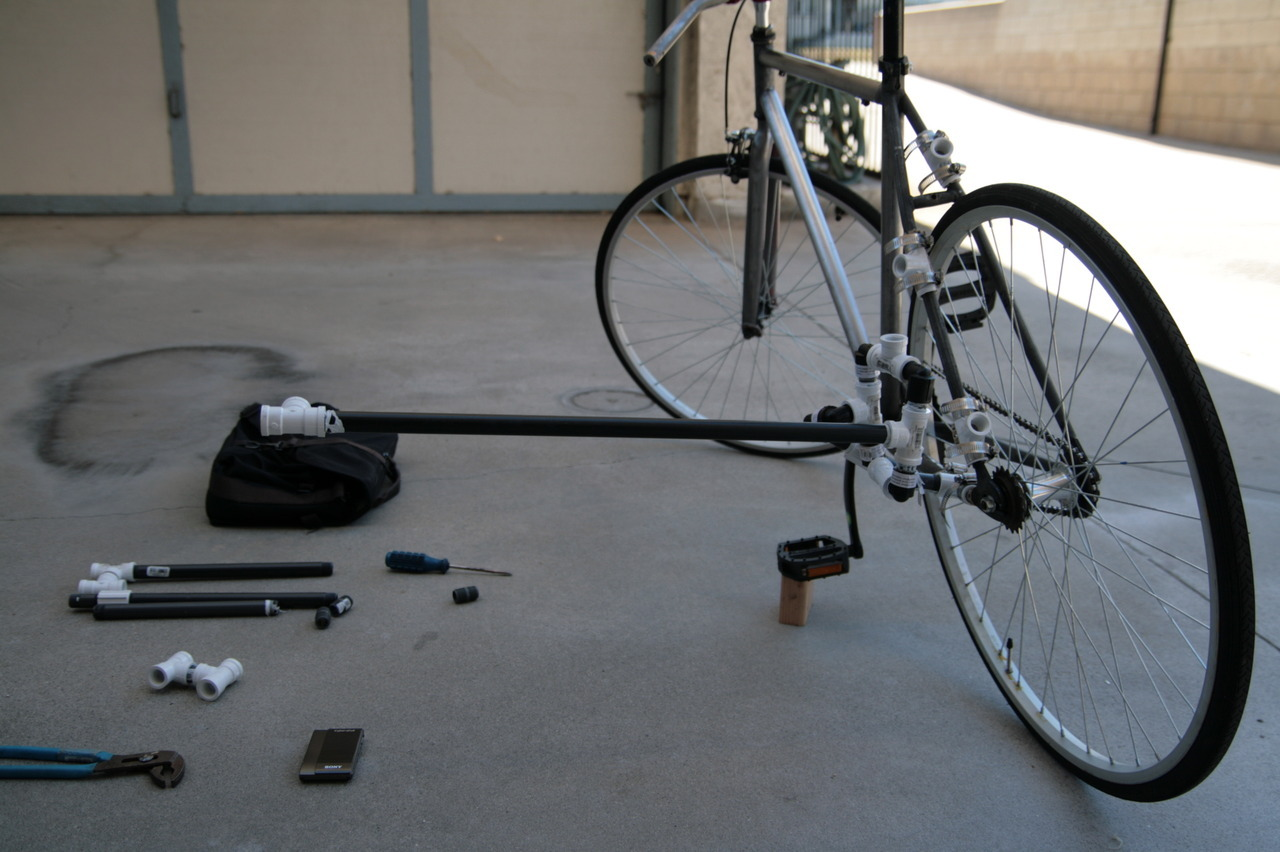 Camera mounting system for a bike for $15.00  Objective: To have a fully adjustable & articulating camera mount for my bike that is cheap, easy to disassemble, fit in my bag, no special tools, light to carry & hold about 15 pounds. p.s.  its actually cheaper than $15.00 Test Shot! http://bikingla.tumblr.com/post/27986853395/test-shot-from-my-camera-mounting-system-for-a