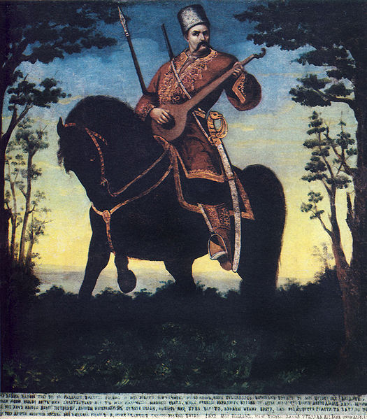Cossack Mamay playing kobza while riding the horse. Cossack Mamay is a Ukrainian folkloric hero, one of standard characters in traditional Ukrainian itinerant puppet theater, the Vertep. Mamay eventually became the national personification of Ukraine and Ukrainians. (Wikipedia)
