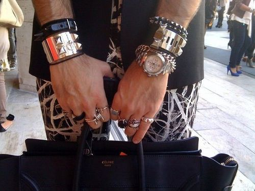 here is a phrase i don't use everyday.  i am jealous of this man's bracelets.