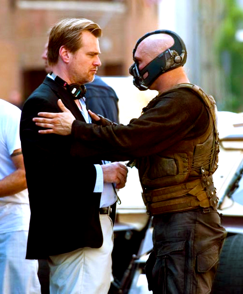 "What is Tom Hardy saying to Chris Nolan in this picture? ""Do you have any idea how handsome I am under this?"" ""I may have just thrown up in the mask."" ""Chris, you're brilliant, but can we hurry up? It smells like old soup in here."" ""If I were into men, you'd be at the top of my list, you beautiful bastard."" ""I knew it was you, Fredo. You broke my heart.""  bohemea:  Figure out how & KISS HIM!"