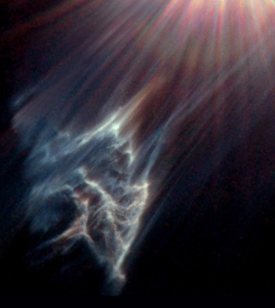 NASA's Hubble Space Telescope has caught the eerie, wispy tendrils of a dark interstellar cloud being destroyed by the passage of one of the brightest stars in the Pleiades star cluster. Like a flashlight beam shining off the wall of a cave, the star is reflecting light off the surface of pitch black clouds of cold gas laced with dust. These are called reflection nebulae.