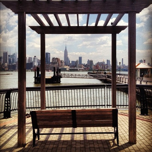 Gorgeous afternoon in #Hoboken yesterday! #nyc #skyline #manhattan #scenery #clouds #sun #water #hudsonriver #bench #gazebo #summertime #bigapple #empirestatebuilding #buildings (Taken with Instagram)