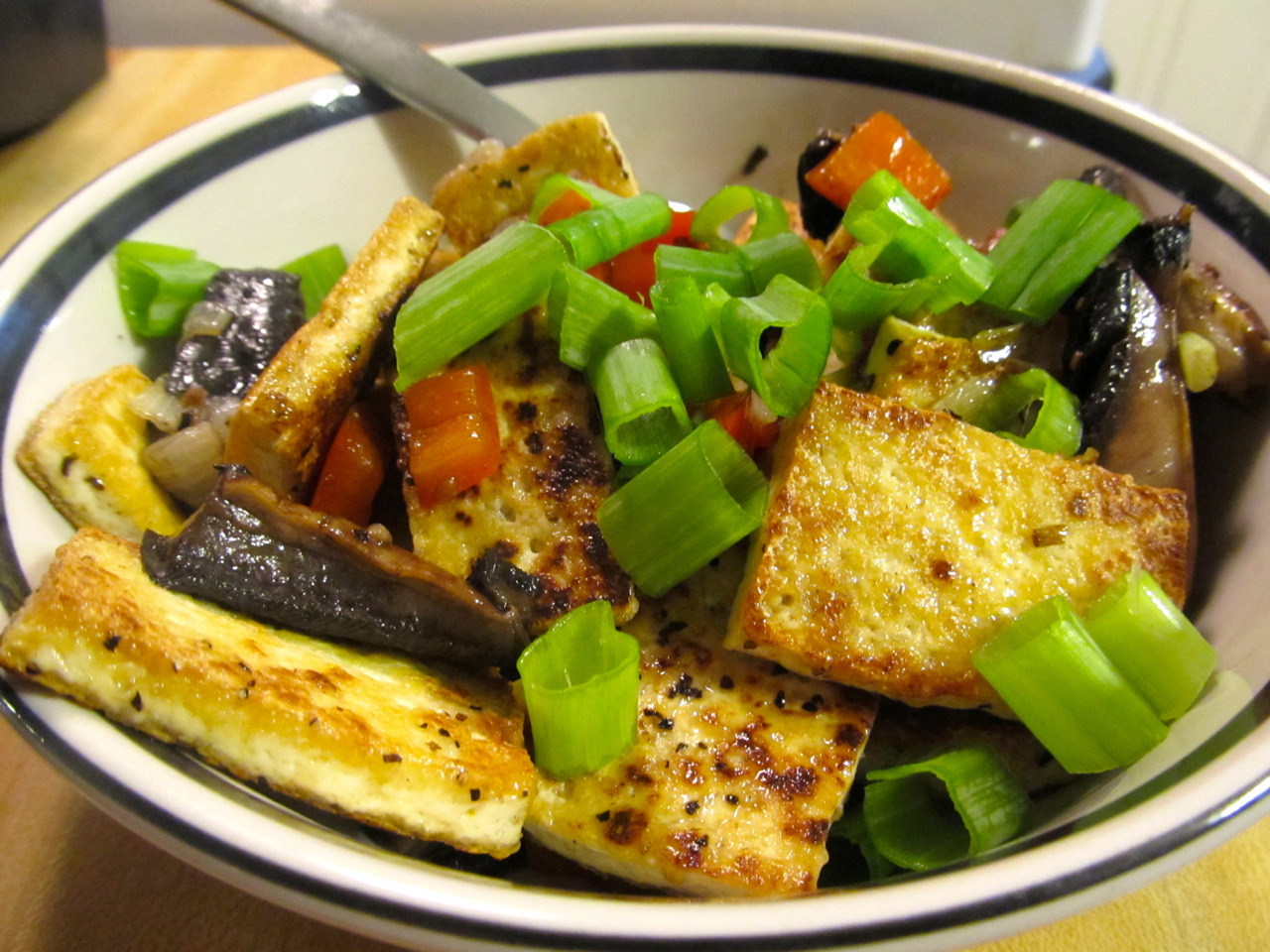 Fried tofu with sautéed portabella, red pepper and scallion, tossed with sesame ginger dressing