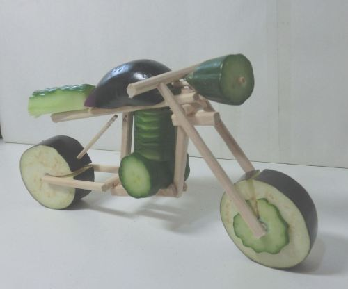 devilduck:  The Dream:  to get on this cucumber bike and, Evil Knievel style, ride it off a ramp into a tall vat filled with iced ginger ale, gin, lemon slices, mint sprigs and Pimm's.