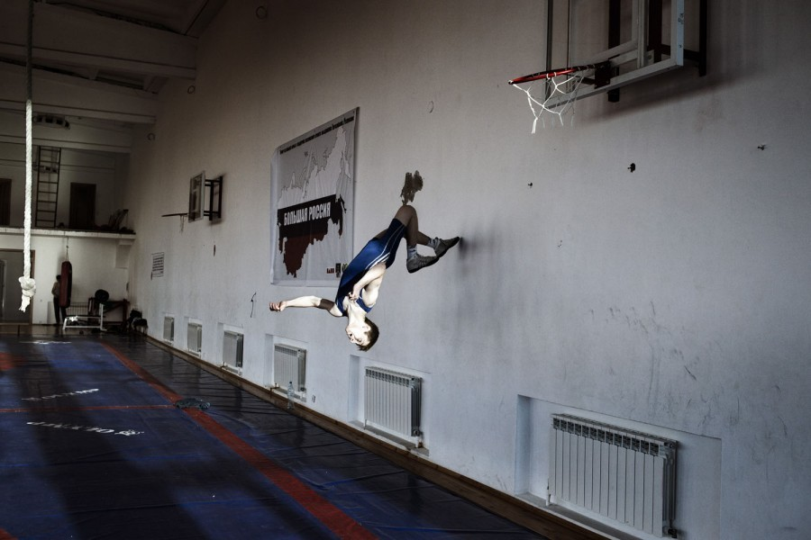 Buvaysar Eskaev, 16, does a backflip against the wall of his gym in Khasav-Yurt, Russia. The dusty Russian town of Khasav-Yurt, which the locals like to call the Wrestlers' Mecca, boasts the greatest concentration of wrestling champions in the world. Photographer Yuri Kozyrev documented the young athletes at their school in the North Caucasus. See more photos here.