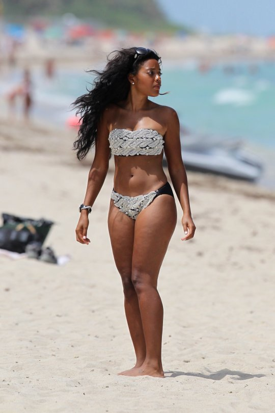 "Angela Simmons in Miami wearing ""Rose By Vanessa Jean."" And, with the sun already shining brightly on the beach…it might be a bit blinding to wear a sparkly embellished swimsuit, but Angela rock'd the look! Style Notes — Vanessa Simmons debuted ""Rose By Vanessa Jean"" during Mercedez-Benz Fashion Week."