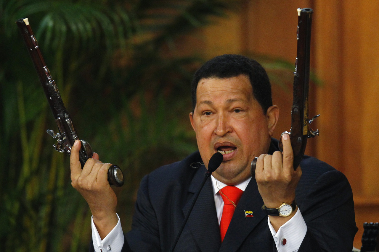 reuters:  Venezuelan President Hugo Chavez shows the pistols of independence hero Simon Bolivar during a ceremony to mark the his birthday in Caracas July 24, 2012. Chavez unveiled a 3D image of South America's 19th century independence hero Bolivar on Tuesday, based on bones he had exhumed two years ago to test a theory that Bolivar was murdered. REUTERS/Carlos Garcia Rawlins FULL FOCUS: The best Reuters images from the past 24 hours