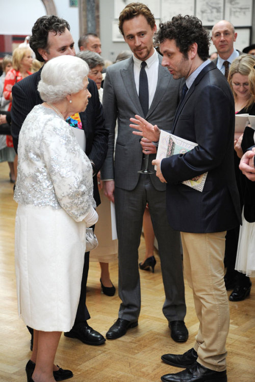 Look at the intelligence on his beautiful face. Queen Elizabeth, Tom Hiddleston and Michael Sheen.