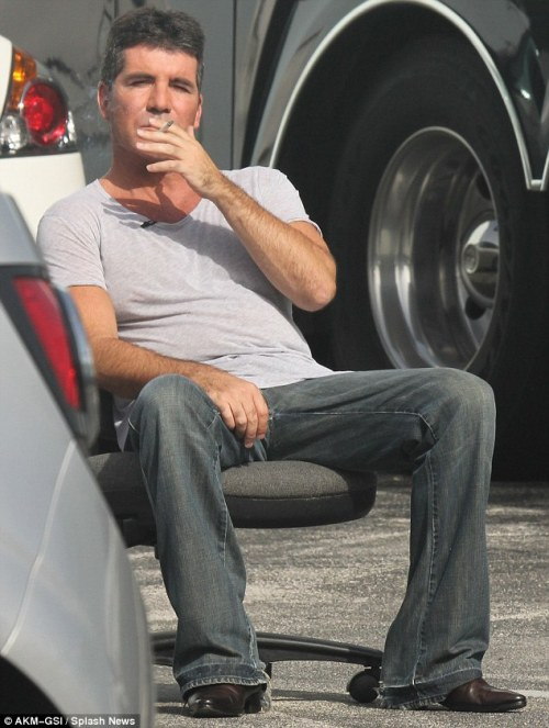 Simon Cowell takes a break from The X Factor USA Boot Camp In Miami Lots more pics HERE