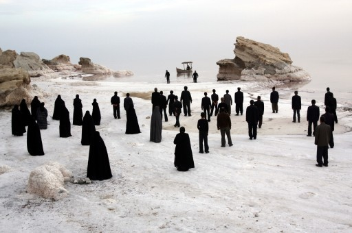 People overlooking the beautiful salt Lake Urmia in Iran before it dries up due to the dam built nearby by the government.  The White Meadows, Mohammad Rasoulof, 2009