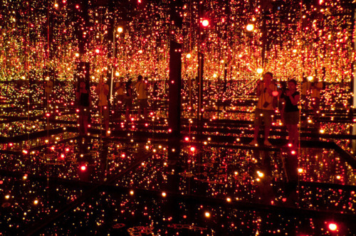 "Fireflies on the Water by Yayoi Kusama An installation which explores ideas of the infinite. Constructed out of 150 suspended lights, and mirrored walls which surround a pool of water. The piece creates a space that individual viewers are invited to ""transcend their sense of self"". Must Watch:"