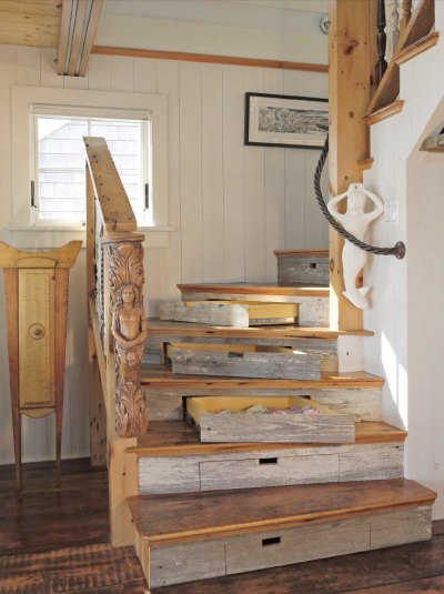 barnwoodanchors:  The staircase is made from reclaimed wood, and each step serves as a storage drawer, making brilliant use of the often unusable space created by this style of staircase design.