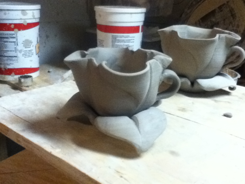Success!!! I finally finished these cups. My hope is that they will become part of an art nouveau tea set inspired by the musee d'orsay on a recent trip to paris. On to the teapot!!!!!