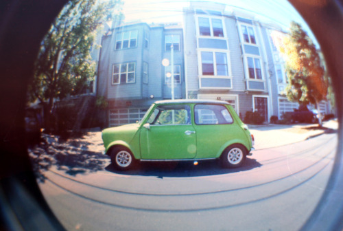 Happiest car on earth. Found at 18th and Shotwell, shot with the toy fisheye.
