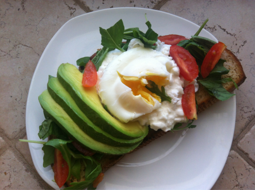 Brunch today  Poached egg on cottage cheese on baby arugula and basil garnished with cherry tomatoes and avocado.   Oh, and how could I forget the grilled garlic sourdough. Top it off with your favorite hot sauce and you got a plateful of fancyyy~