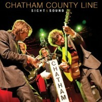 Dennis' Other Bonus Review: Chatham County Line: Sight & Sound (Yep Roc) Raleigh, North Carolina-based Chatham County Line has been writing some of the best pure singer-songwriter material in the past decade. Billed by most as a bluegrass outfit, as is often the case with acoustic, drum-less outfits operating outside normal genre constrictions, it's a description that badly misses the mark. This live set functions as a primo introduction to a band that's far more in tune with Yonder Mountain String Band and Old Crow Medicine Show than any traditional grass band. Lead singer-prime songwriter-guitarist Dave Wilson has real presence, a voice clear and true belting out confident, unsentimental observations. The blend of singers and instruments in Chatham County Line is so damn nice, and they pull off what they do so well in the studio just as well in concert on Sight & Sound (released July 10), huddled around a single mic to deliver a cohesive, utterly solid case for their inclusion in any list of Americana's top tier acts today. (DC) From: Albums of the Week | July 23-July 29 | Dirty Impound