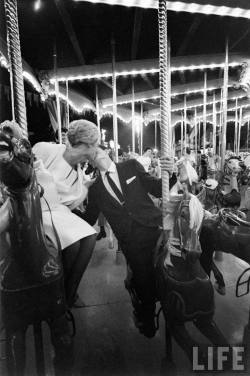 takewhatyouneedtoday:   All-night prom at Disneyland, 1961.By Ralph Crane.  kiss me around the carousel.