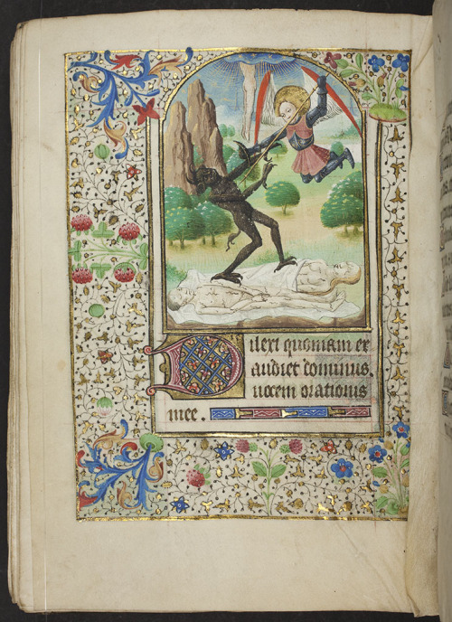 "jothelibrarian:  Pretty medieval manuscript of the day shows St Michael fighting the devil for the souls of two corpses. According to the library:  ""This Book of Hours was copied in Eastern France between 1425 and 1475. The miniature featured here is one of twelve large miniatures in gold frames, arched at the top and with three or four lines of text underneath. This leaf shows the beginning of the psalm for first vespers in the Office of the Dead. The miniature shows St Michael fighting a devil over two corpses; a third 'corpse' is ascending into heaven. The full border is a floral-acanthus design with twining ivy leaves. Immediately below the miniature is a 3-line initial in red, blue and orange with white tracery on a gold ground. The last line of text is completed with a line filler""  There is plenty here for the modern viewer to find peculiar, but the thing that strikes me as the oddest thing is the sight of a body ascending (or descending?) from heaven. The site of a torso and legs hanging from the celestial heavens, whilst St Michael and the devil fight like cat and dog is downright bizarre! These artists certainly had a tricky time, trying to find new ways to depict extraordinary stories! Image source: Alexander Turnbull Library MSR-02, National Library of New Zealand. Image released into the public domain via the Flickr Commons."