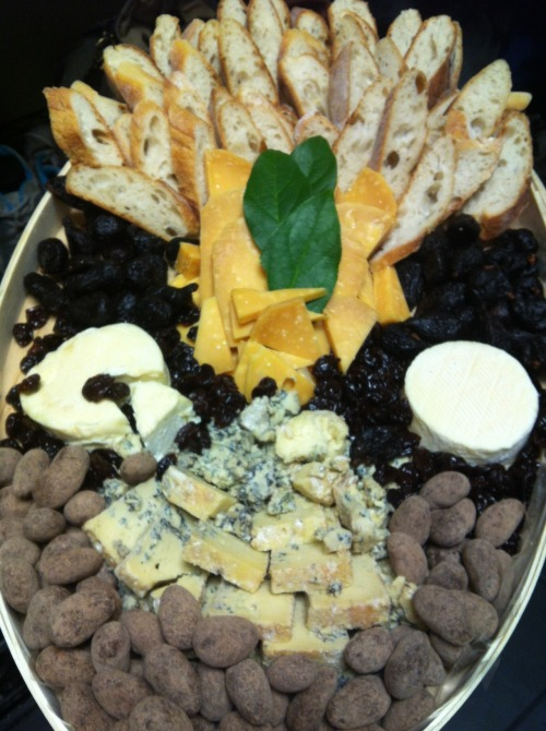yoursincheese:  Building catering trays is one of my favorite things to do.   rartastic replied to your photo: Building catering trays is one of my favorite… Please to describe everything on that tray. Of course! This is our Sweet Dreams tray. Cheese makes for a great desert, you know. Starting at the top and moving clockwise (ignoring the bread): Five Year Gouda (Candy Cheese!) Dried mission figs Dried cherries Cremont Piedras de chocolate Roaring Forties Blue One Cremont is never enough Not pictured: two jars of Quince & Apple's custom Apples in Sparkling Wine preserves, made just for Pastoral.   marleymarley replied to your photo: Building catering trays is one of my favorite… I want to do a belly-flop on that thing and just roll back and forth for a minute. You've summarized the required restraint perfectly!