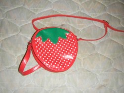 Selling this Red Bodyline Strawberry Bag $20 + Shipping - used 4 times, like new - no wear or tear - strawberry shaped bell still intact  EDIT: SOLD!!