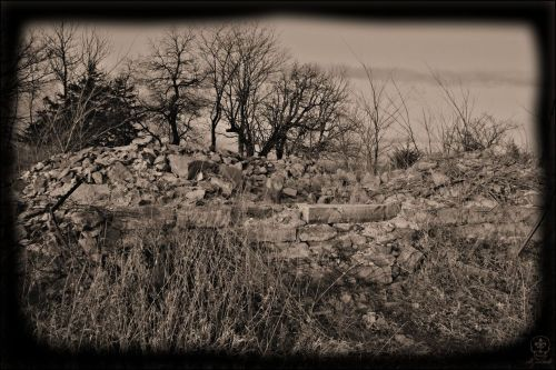 "Stull, Kansas.  Remains of the Evangelical Emmanuel Church at Stull, built ~1867. ""Legend also has it that glass won't break if thrown against the stones of the church…. It was claimed that despite not having a roof, no rain would fall inside the old church on the hill. People said they have been subjected to a strong wind that held them down on a still night and sinister growls that came out of thin air encircling passersby. Almost everyone you speak to has a story about how 'something' happened to them at Stull. Almost everyone that is, except for the 30 or so residents of Stull, Kansas. They claim the only thing special about that cemetery is the fact their loved ones are buried there…."" darkendofthestreet.net"