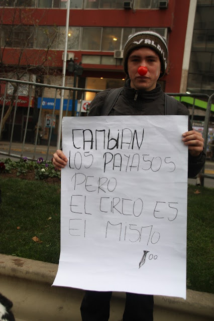 """They Change The Clowns But The Circus Is The Same"" June 28, Santiago Source"