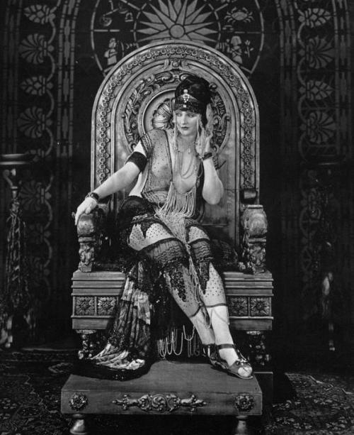 greypoppies:  Betty Blythe in The Queen of Sheba (1921). The role of Sheba was originally intended for Theda Bara, but Bara chose not to renew her contract with Fox Studios after an agreement couldn't be reached with producer William Fox. The film is well known for Blythe's risqué costumes, a rarity in Hollywood films at the time. The topless scenes from the movie were included only in the European released version of the film. Unfortunately, this is another lost film with the only remaining negatives destroyed in a vault fire in NJ, 1937. In a bit of good news, a 17 second fragment of the film was found in May 2011.