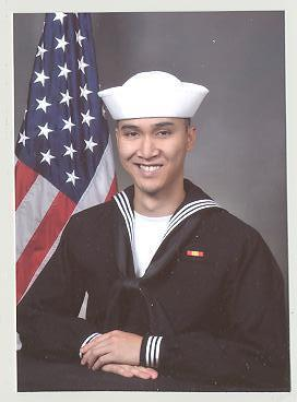 "My first photo as a ""sailor"".  Damn, sleepless nights and long working days.  Photoshop did justice for the bags under my eyes.  I hated boot camp so much.  Easy as hell, but wouldn't go through it again."