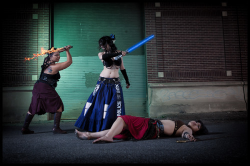 """Bellydancing TARDIS with a lightsaber. Your argument is invalid."" TARDIS skirt made by Dawn Xiana Moon for Raks Geek, a geek + bellydance + fire show in Chicago.  submitted by Dawn Xiana Moon"