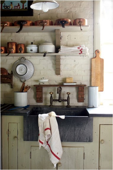 Lovely rustic kitchen, love the copper pans