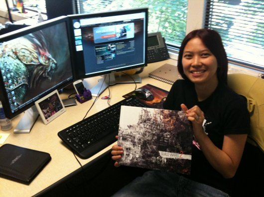 gamettescribe:  She's Regina Buenaobra, Community Manager of Guild Wars 2. So, what about her? Well, she's born a Filipina, but raised in America. So yeah. We kinda have this Filipino pride and I feel happy that there's a Filipino in the ArenaNet team. :P Also, she's doing pretty impressive stuffs outside ANet, like writing about videogames, the gaming culture, the perspective of underrepresented gamers and other interesting things. You can check her website here: http://reginabuenaobra.net/ ;)  Oh hey, that's me. That's an old picture we tweeted out a few years ago. :-)I haven't been back to the Philippines since 2003. Probably won't be going back for a while. What I miss most is the food! You can't get calamansi juice (which I don't drink with any sweetener), the same green mangoes they have in the Philippines, or santol (om nom nom) here in the States.Mabuhay to all the Filipino Guild Wars 2 fans. :-)