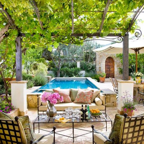luxury patio with a dreamy pergola and pool. who needs vacations?