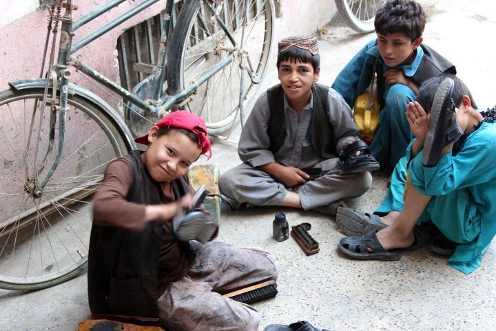 Most children in Afghanistan polish shoes for money. You will see in a street even 5 children setting up their own corner and competing to get customers. Polishing one pair of shoe gains then 10 to 20 afghani ( aprox. 20 to 40 US cents ) but that depends from place to place. These children should be in schools, but the conditions of their families force them to work under harsh environments. In hot summers, and in cold winters you will always find them there. Most of these children have lost one or both of their parents or they are the eldest of the family which in Afghanistan makes it compulsory on you to take care of the rest of the family. While these children work hard, All they actually want is a normal life and enjoy their childhood, go to school and play like any other children. While in kabul, i saw how these working children used to look at other children whom were fortunate enough to go to schools. Their looks were those of dreams and hope of some day they will also go to one. or at least of a normal life.