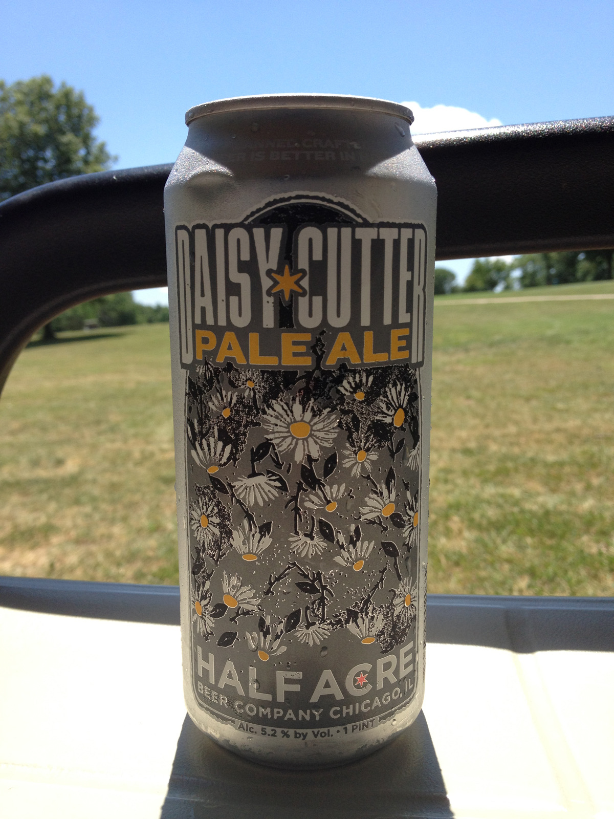 439. Half Acre Beer Company – Daisy Cutter Pale Ale As you could tell by my last few posts, I'm in Columbia, MO for a golf tournament.  We're out on the course and I've already had a Two Brothers Outlaw IPA my friend Joe brought back from a recent trip to Chicago.  He also brought back this one from Half Acre Beer Co.  It was hard to review it on the course, so Joe shared another can with me to take a little more time review later in the evening. Location: Enjoyed in the can at Lake of the Woods Golf Course in Columbia, MO. Numbers: 5.2% ABV, ~ 160 Calories Appearance & Aroma: When I poured it in a glass, it was dark golden in color with some orange hues, and slightly hazy.  It had a big foamy head on it, which stuck around for a bit and left some very nice lacing on the glass as I drank it.  There was a nice, big grapefruit aroma with some resiny and piney notes. Taste & Feel: The body was light-medium and the mouthfeel was smooth with a bit of crispness on the end of each sip from the hops.  There was a quick moment where I tasted… (More on Half Acre Beer Company – Daisy Cutter Pale Ale)