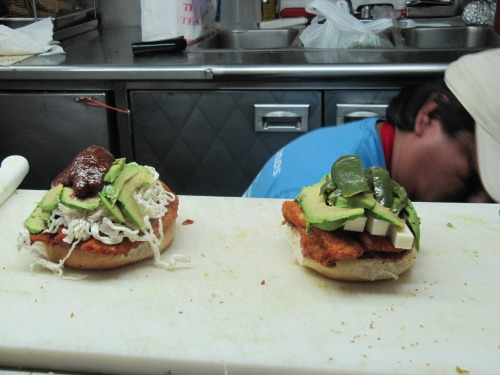 queenslove:  The difference between a torta and a cemita at the Tia Julia truck At left, the cemita, with quesillo cheese, papalo herb, chipotle salsa, hugged in a round sesame seed bun. It's the deluxe version of the torta (Mexican sandwich) from Puebla. Given the choice, and the extra dollar, always get the cemita. Tia Julia truck, SE corner, Roosevelt & Benham, Jackson Heights