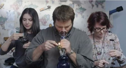 Want to see the actual video where Ron Swanson smokes with his wife AND Allison Brie. Obviously. Click here.