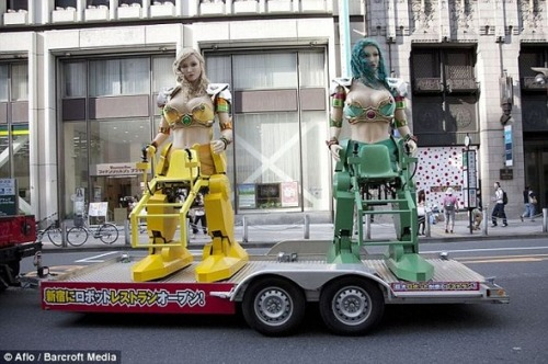 The Robot Restaurant in Tokyo offers a brand new way to entertain its visitors. Giant robots with female torsos operated by girls in bikinis roll among the tables and dance for the audience. via Daily Mail