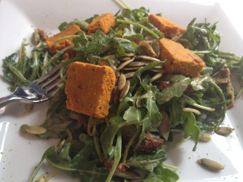 Baby arugula salad from Organic Avenue w/ sun dried tomatoes, pumpkin seeds and carrot cheez.