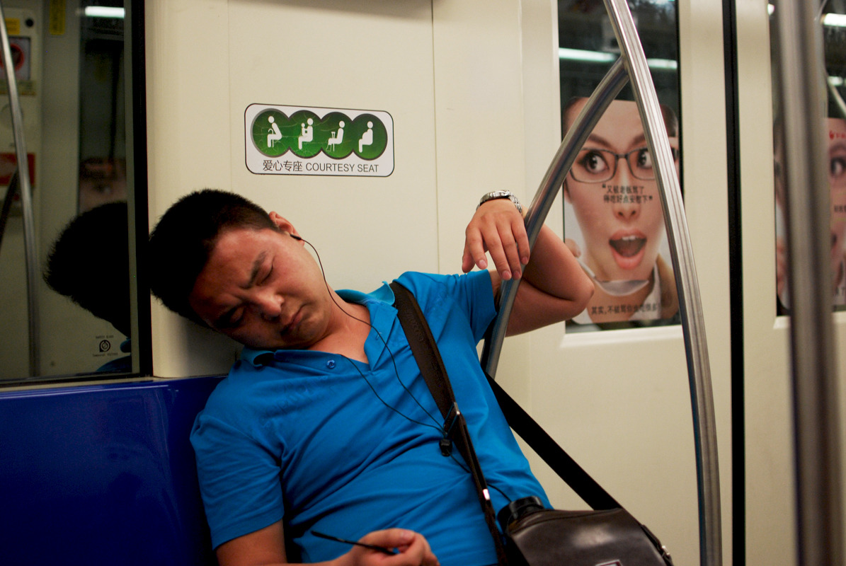 Sleeping in the subway. Shanghai, China, 2012. Alex Muntean
