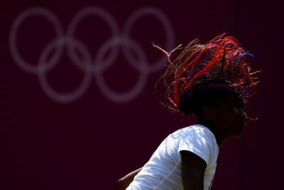 olympics:  Venus Williams of the United States in action during the practice session ahead of the 2012 London Olympic Games at the All England Lawn Tennis and Croquet Club in Wimbledon Photo by Clive Brunskill/Getty Images
