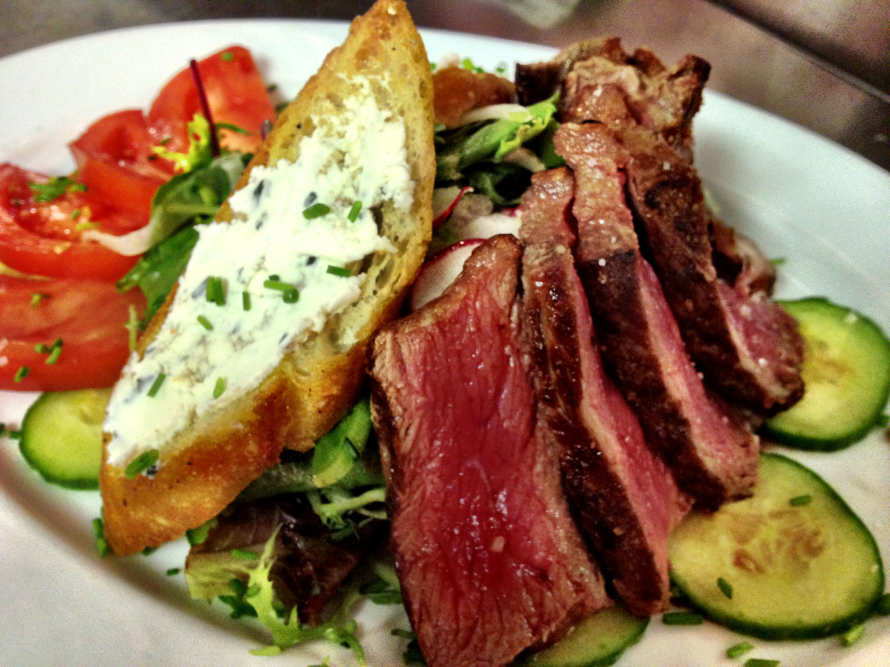 Menu item of the day: Sirloin Steak Salad with arugula, tomato, cucumber, goat cheese crostini.  Lunch menu $18