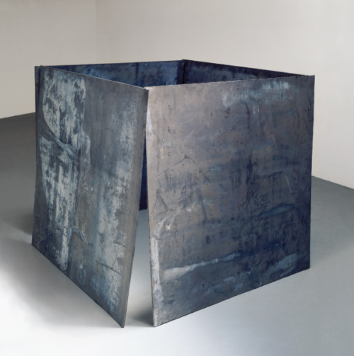 "Richard Serra - House of Cards, 1968-69 ""I had built, I think, six or seven large lead pieces, all dealing with the relationship of a pole and a plate to the wall. But I got very dissatisfied with the wall pieces that somehow they were still dealing with some sort of pictorial convention. And I wanted to move the pieces out onto the floor. And so we decided to take four lead plates and just lean them up like a house of cards. And that piece weighed about a ton: it was called One Ton Prop. And that was the beginning of a whole series of pieces dealing with basic tectonics of building. I nicknamed it House of Cards. Once you understand how the House of Cards is being held in terms of one edge leaning against the other holding up all four plates then you can think, what if you took these plates apart? Could you hold all four of them up simply with a roll overhead?"""