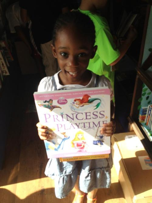 firstbook:  This little girl loves her First Book book!
