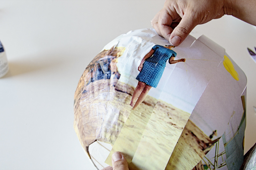 photojojo:  DIY: How to Customize Paper Lanterns with Photos! You've seen those paper lanterns in stores. Wouldn't that plain paper look so much cooler with your own colorful photos on them? We put together a how-to on doing just that! Click the link above to check it out.