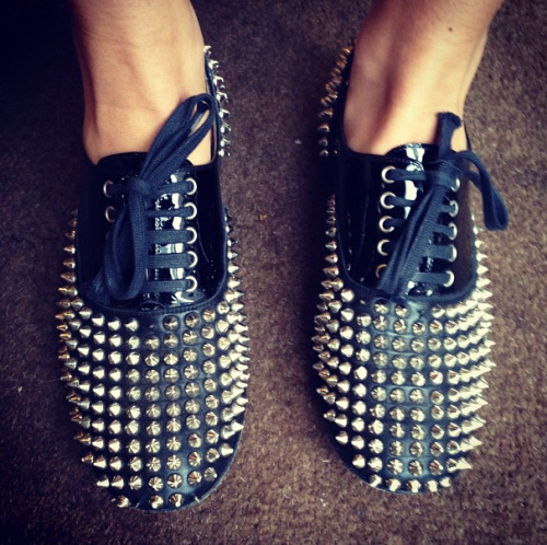 teenvogue:  Studded Christian Louboutin lace-up oxfords on Bergdorfs' Cannon Hodge