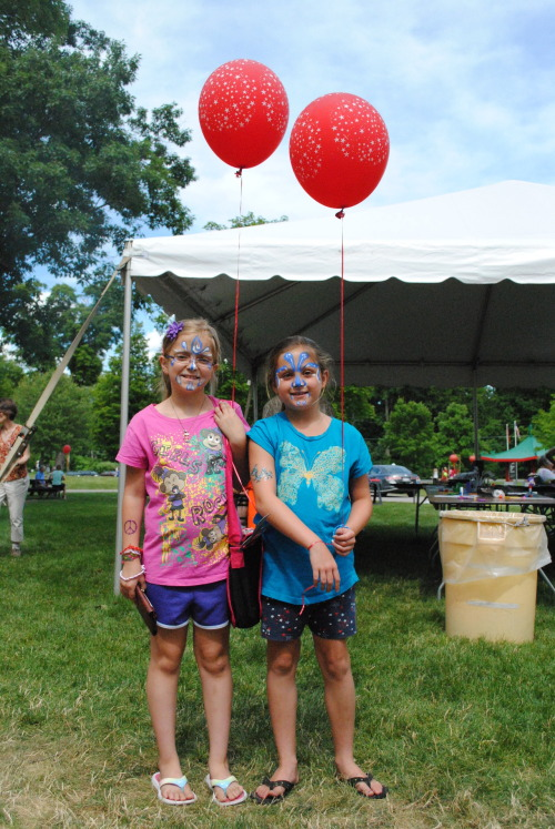 Two young visitors show off their balloons - and painted faces - during the Clark's Family Day 2012, which was themed as a Chinese street festival.