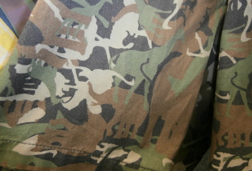 (capsule) Call Out: Ian Velardi's Clever Camo Spotted amongst the crazy good continental menswear Ian Velardi (one of GQ's Best New Menswear Designers in America) was stocking in his (capsule) trade show space was this tounge-in-cheek take on traditional camouflage pattern.