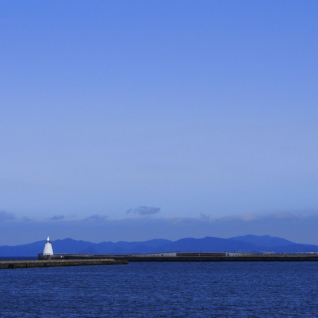 Blue sky, sea, mountain and white lighthouse by marco ferrarin on Flickr.